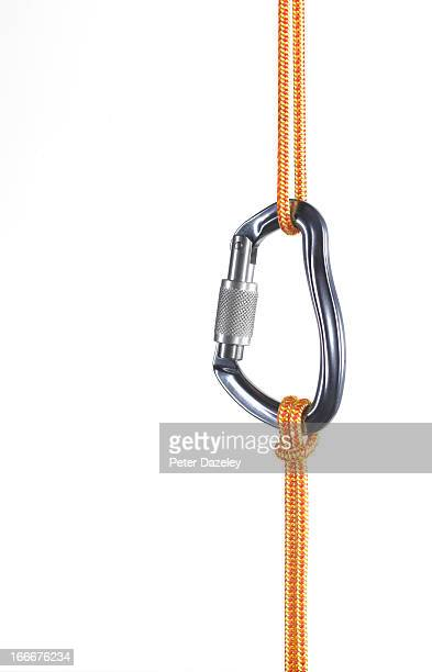 Orange climbing rope connected by karabiner