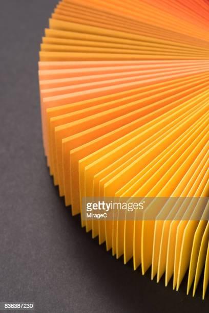 Orange Colored Paper Cards Fan Out Shape