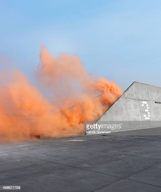 Orange colored smoke in urban area