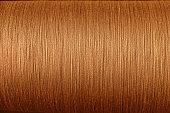 orange cotton thread from weaving machine, Abstract background