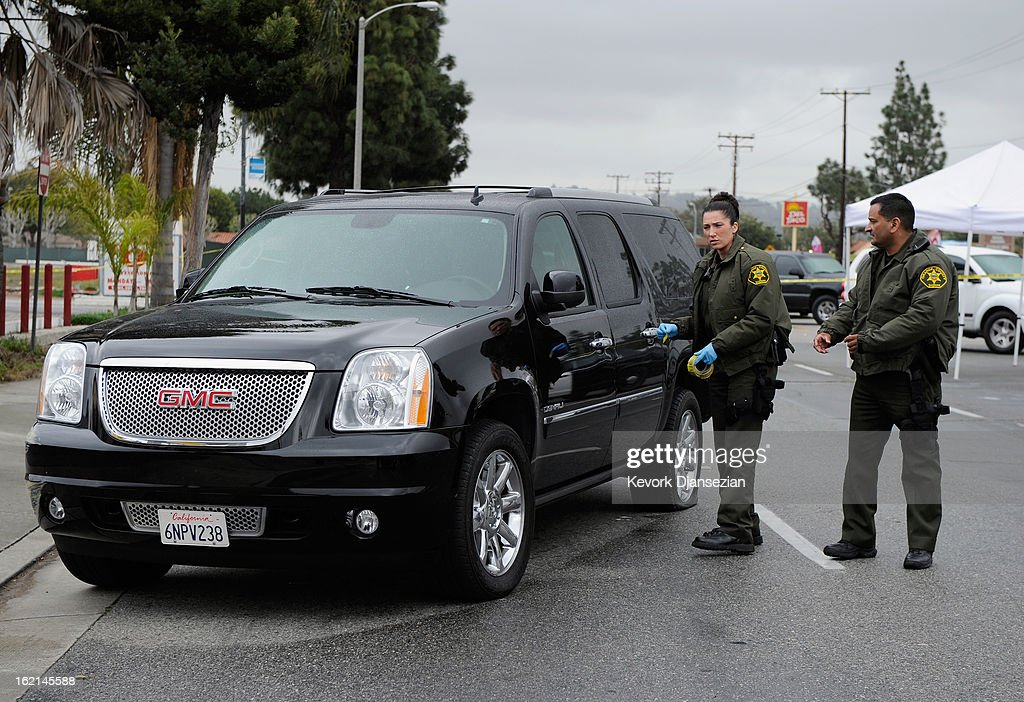 Orange County Sheriff deputies investigate a crime scene on February 19, 2013 in Tustin, California. According to law enforcement officials six people were shot in cities of Tustin, Ladera Ranch and Orange, four of them fatally, including the suspected shooter, who apparently killed himself.