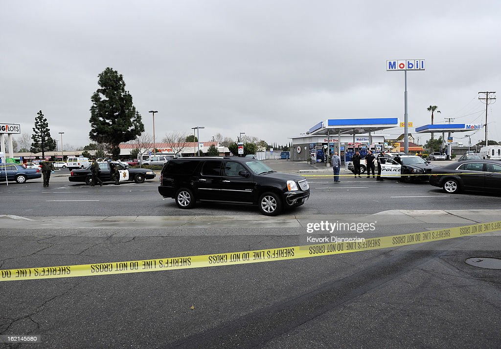 Orange County Sheriff deputies investigate a crime scenes on February 19, 2013 in Tustin, California. According to law enforcement officials six people were shot in cities of Tustin, Ladera Ranch and Orange, four of them fatally, including the suspected shooter, who apparently killed himself.