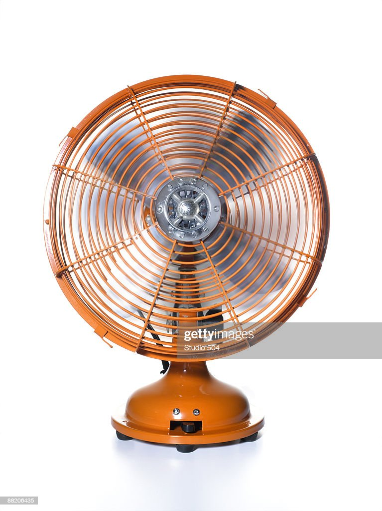 Orange fan with rotating blades : Stock Photo