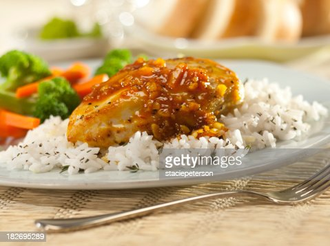 Orange glazed chicken breast with rice.