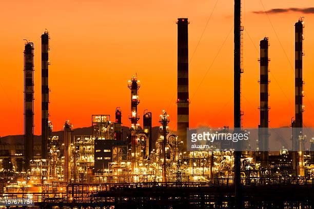 Orange gradient petrochemical plant buildings