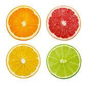 Slices of orange, pink grapefruit, lemon and lime fruits isolated on white background