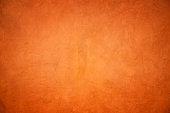 Orange grunge concrete wall textured and background.