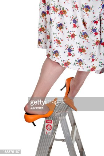 orange heeled woman slips off ladder
