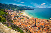 upper view of the bright orange houses near the sea, Cefalu, Sicily, Italy