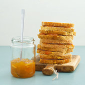 Orange jam sandwiches piled up and and marmalade jar