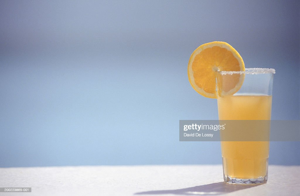 Orange juice in glass with slice of orange,  ground view, copy space : Stock Photo