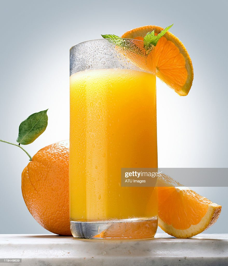 Orange juice on marble ledge : Stock Photo