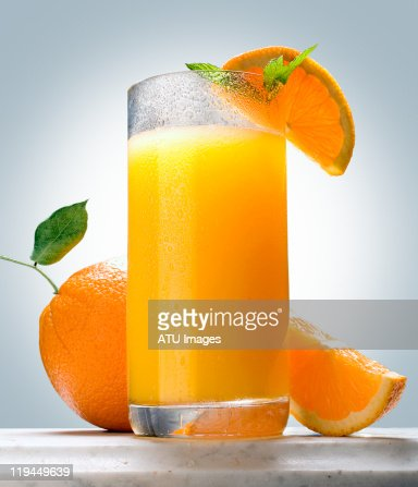 Orange juice on marble ledge : Stockfoto