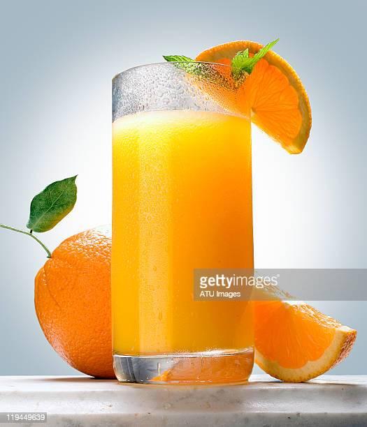 Orange juice on marble ledge