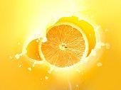 Orange falling into the orange juice