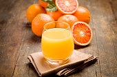 fresh squeezed orange juice on ancient wooden table