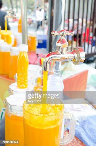 Orange juice pouring : Stock Photo