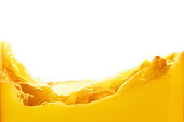 Orange juice splash isolated on white background. Healthy fresh drink, wave with drop
