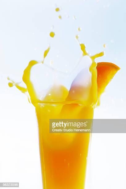 Orange juice splashing, close-up
