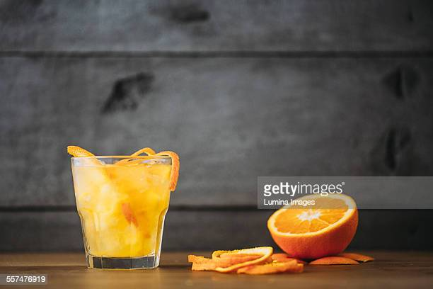 Orange juice with peel and sliced fruit