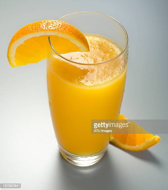 Orange juice with wedge and pulp