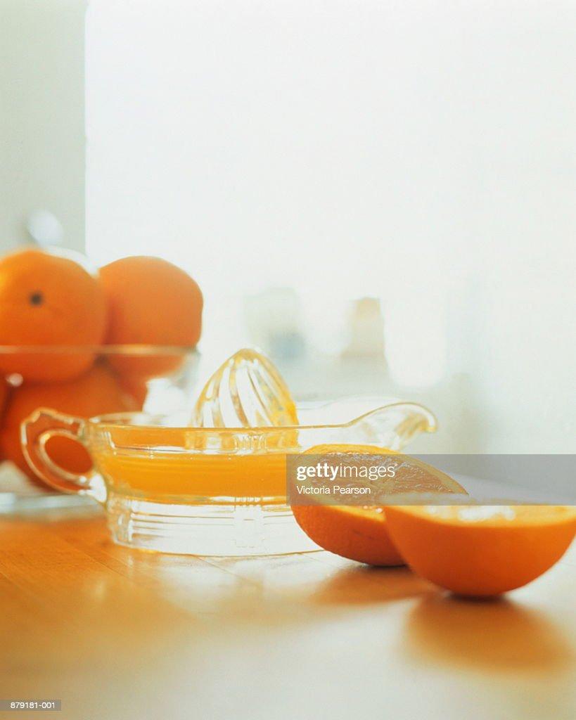 Orange juicer and oranges : Stock Photo
