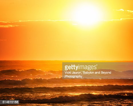 Orange Layers of Sunrise Over the Ocean at Fire Island, Long Island : Stock Photo