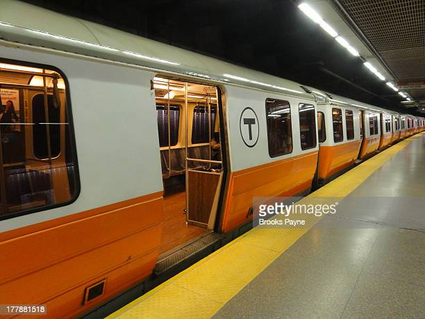 CONTENT] MBTA orange line subway train at Back Bay Station