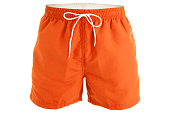 Orange men shorts for swimming isolated on white background