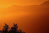 Orange mist over mountains