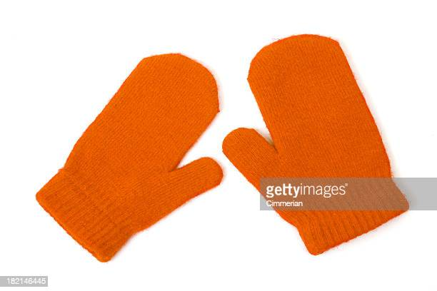 Orange mittens on white