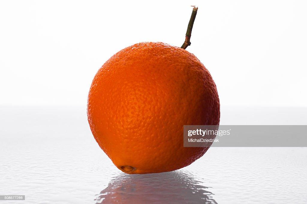 Orange on glass table : Stock Photo