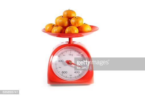 Orange auf roten Gleichgewicht : Stock-Foto