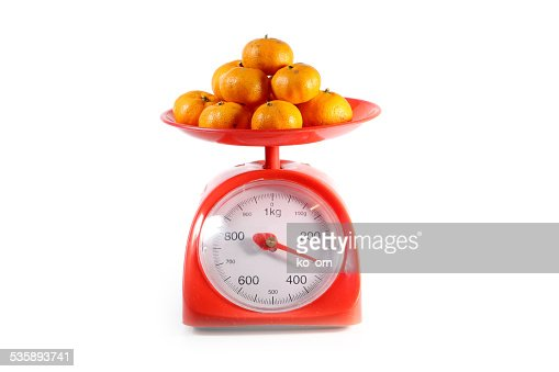 Orange on red balance : Stockfoto