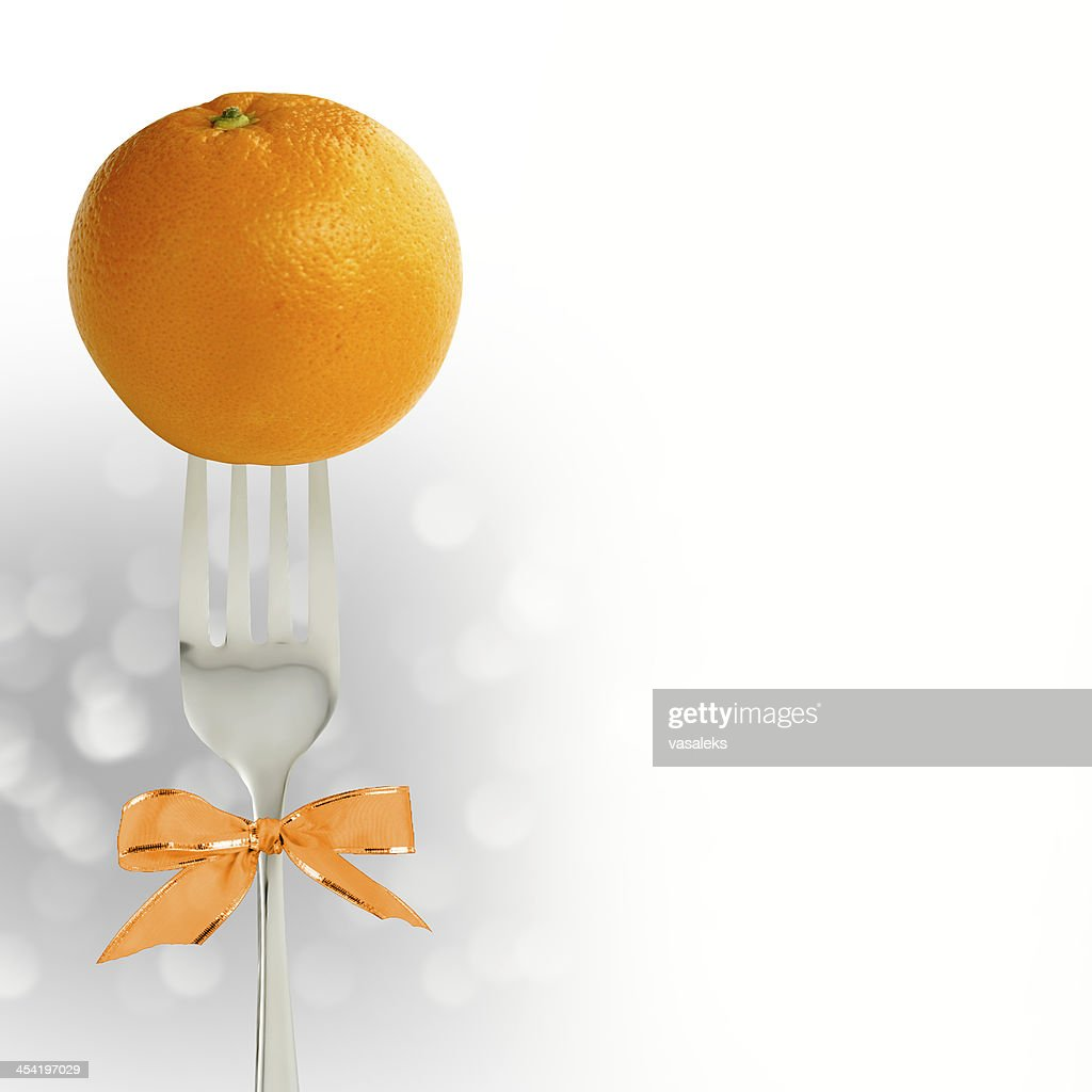 Orange on the fork : Stock Photo