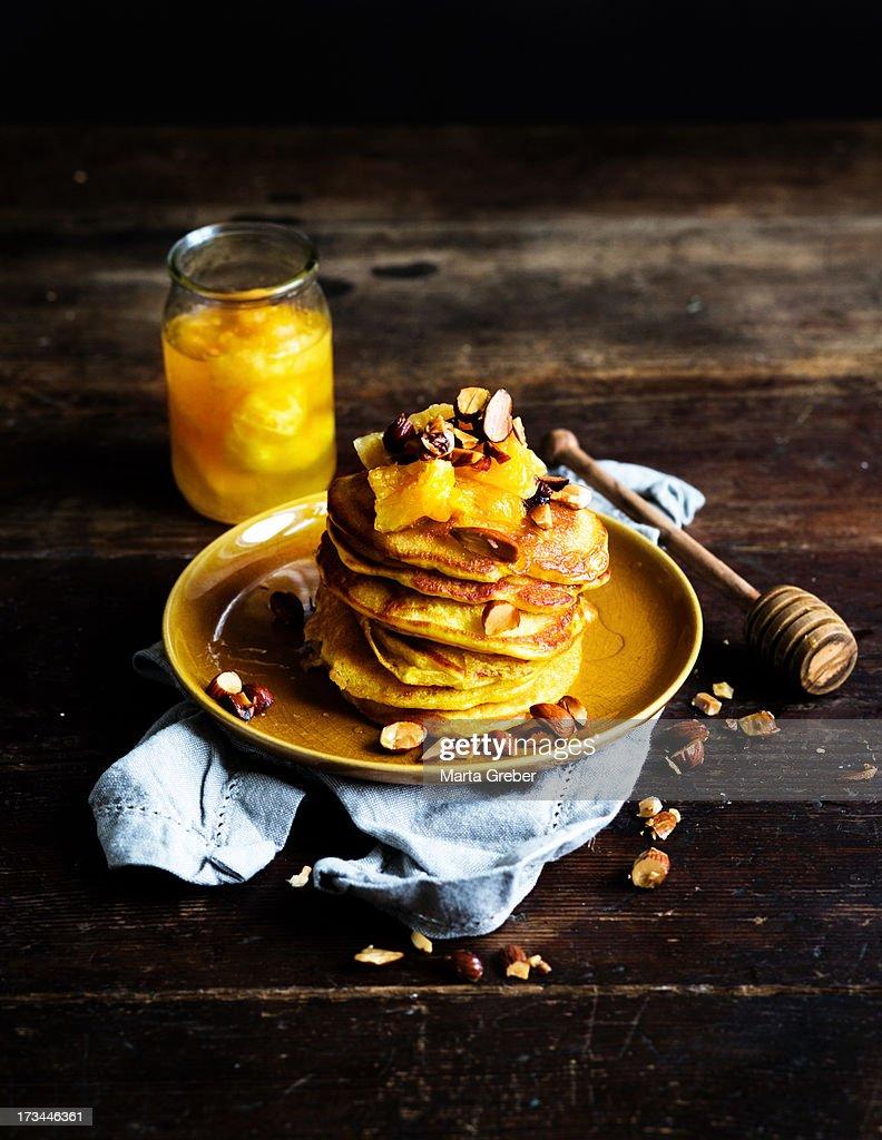 Orange pancakes with caramelized oranges and roast : Stock Photo