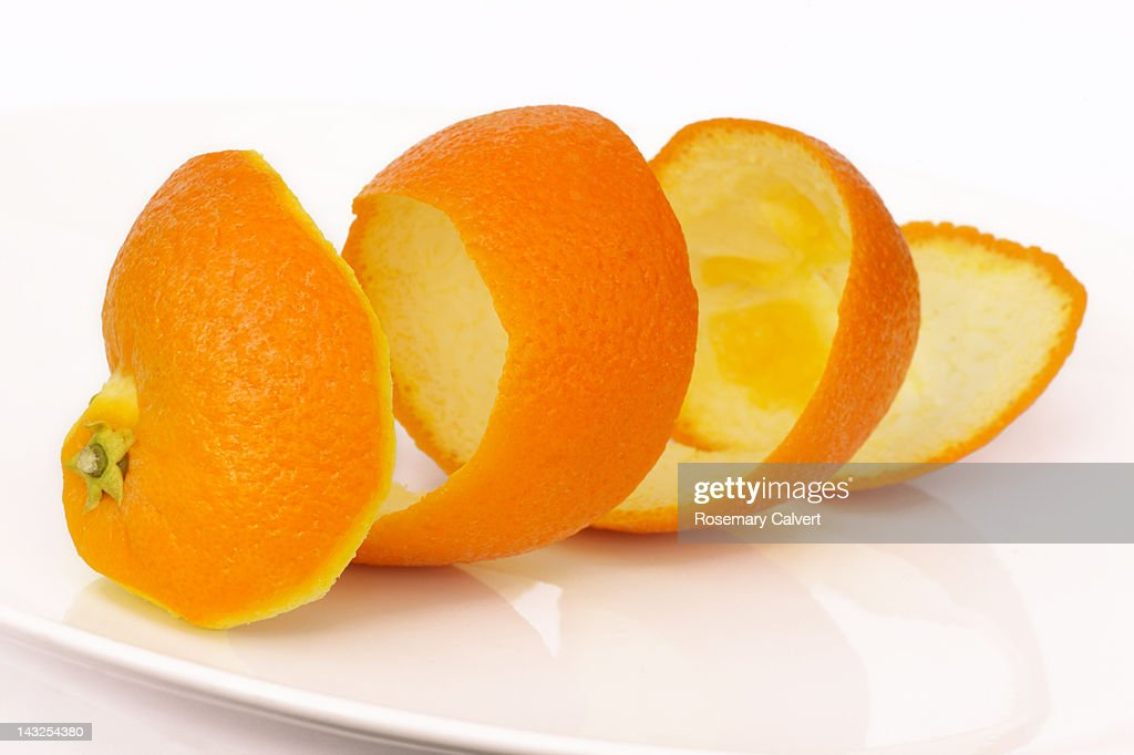 Orange peel in a coil, an unravelled orange : Stock Photo
