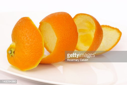Orange peel in a coil, an unravelled orange : Foto de stock
