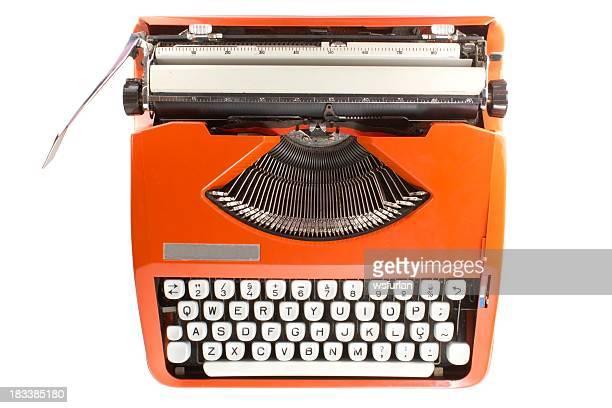 Orange retro typewriter with white keys