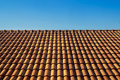 """orange roof tile house against blue sky and warm sunlight at the summer time. housing and real estate concept.""""n"""
