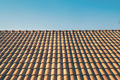 orange roof tile house against blue sky and warm sunlight at the summer time. housing and real estate concept. vintage photo and film style.
