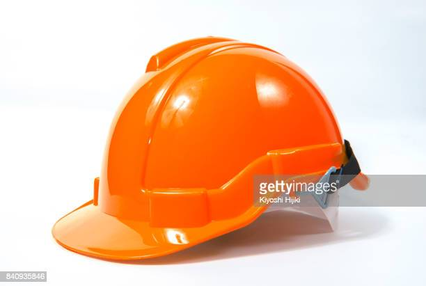 Orange safety helmet on white background