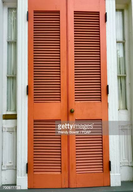 Orange shutters of house
