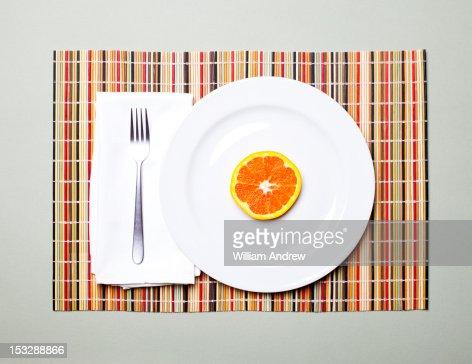 Orange slice on a plate : Stock Photo