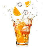 orange slices and ice cubes dropping into a splashing cocktail isolated on white background