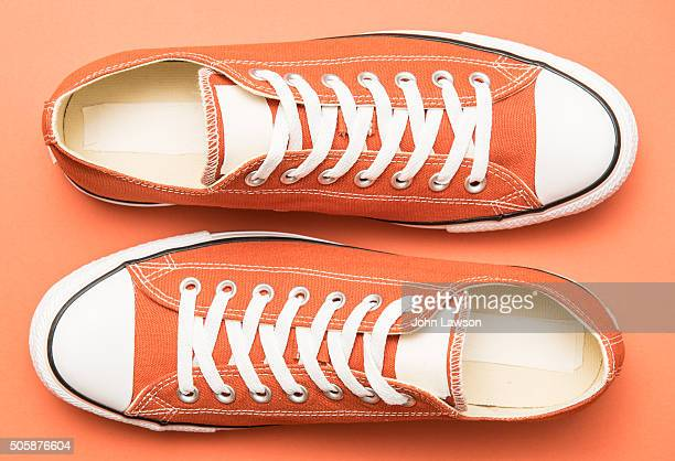 Orange sneakers on an orange background