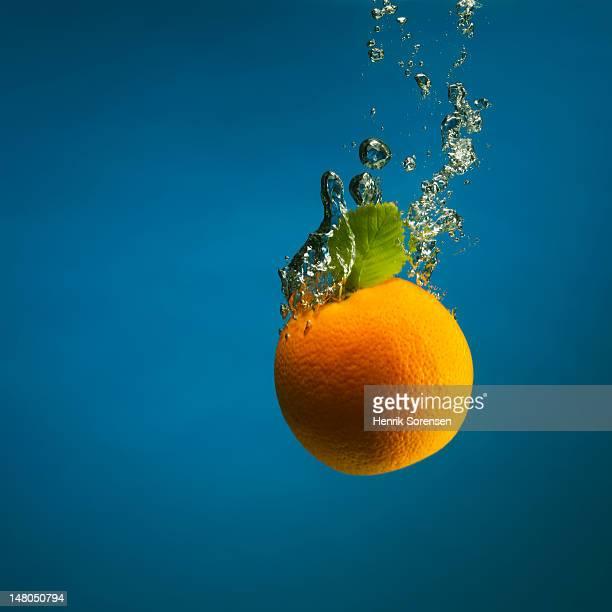 orange splashed into water