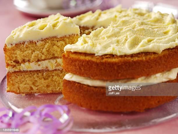 Orange sponge cake with frosting, close up