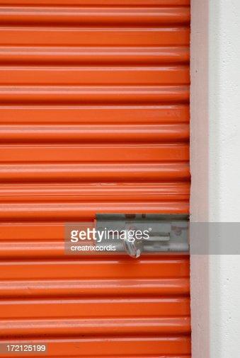 orange storage steel door with padlock