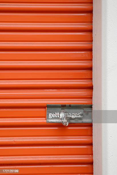 orange storage steel door with padlock